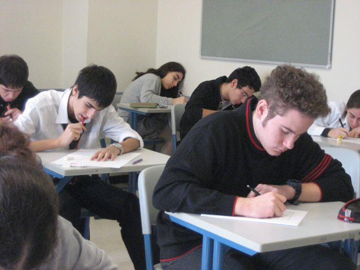 group of students taking an exam