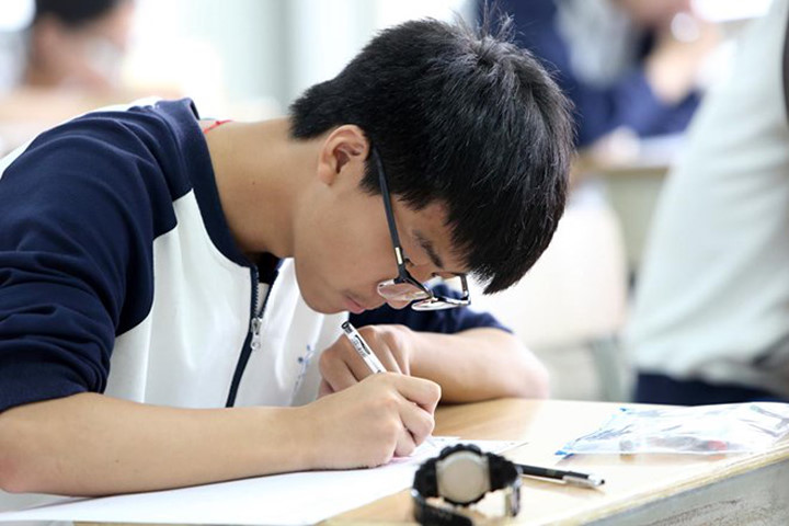 side view of a boy taking an exam in china