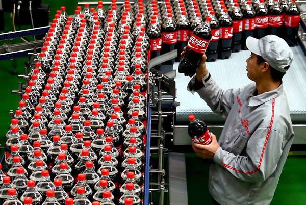 worker on a production line at a coke factory in china