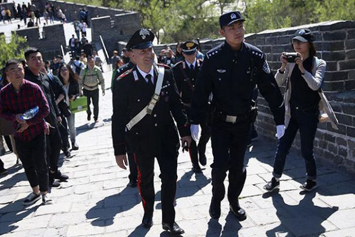 chinese and italian police on patrol at the great wall