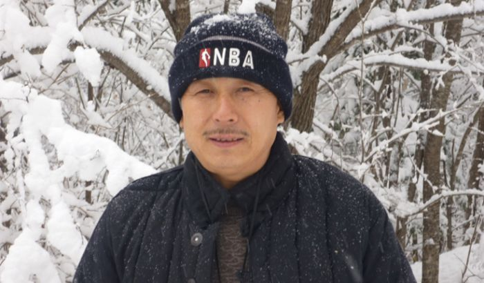 a man in the forrest during winter