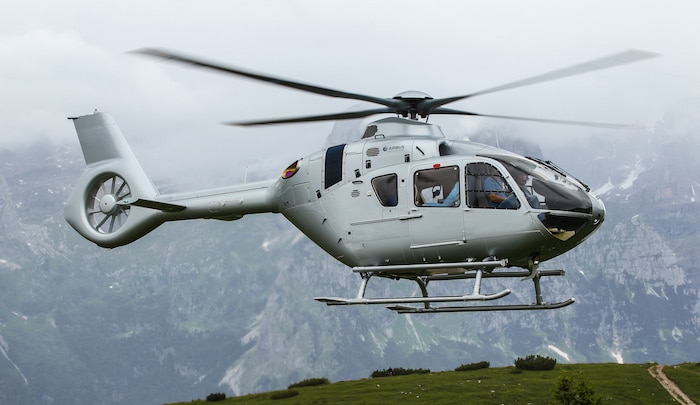side view of an airbus helicopter in flight