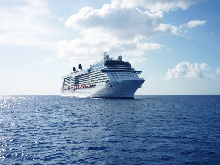 front and side view of a cruise ship at sea
