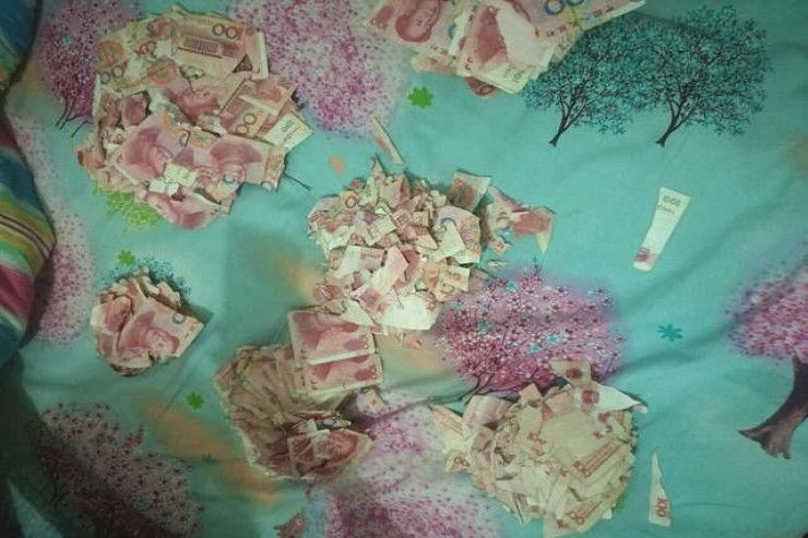 torn up money on a table in china