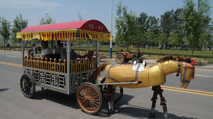 side view of a mechanical horse pulling a carriage in china