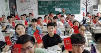 students in a classroom holding hongbao in china