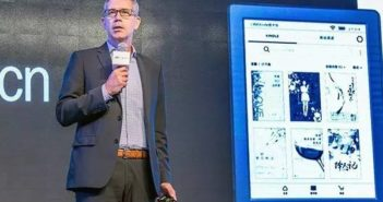 man on stage presenting a new kindle for china market