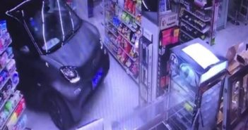 video footage of a car driving into a shop