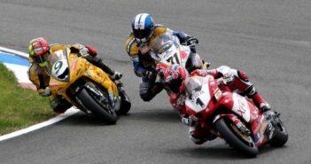 Superbikes rounding corner during race