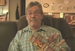 man at home with lottery ticket