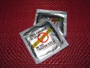Condom with packet stating it is illegal