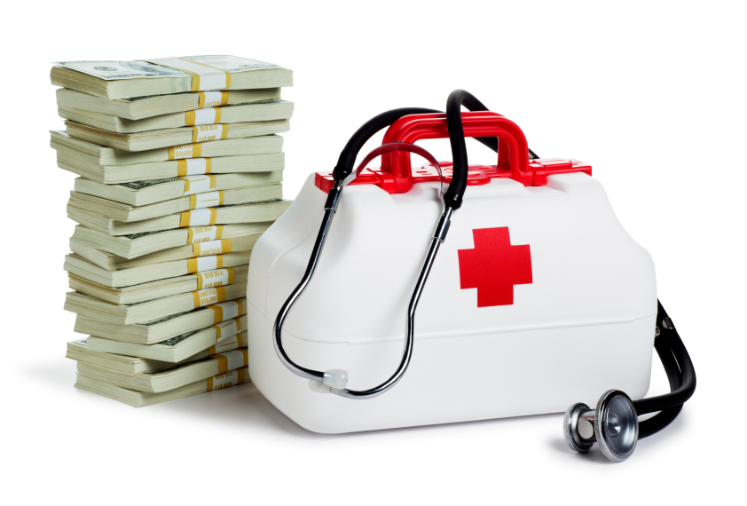 Stacks of money with a medical kit