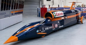 First 1000mph blue and orange car in garage