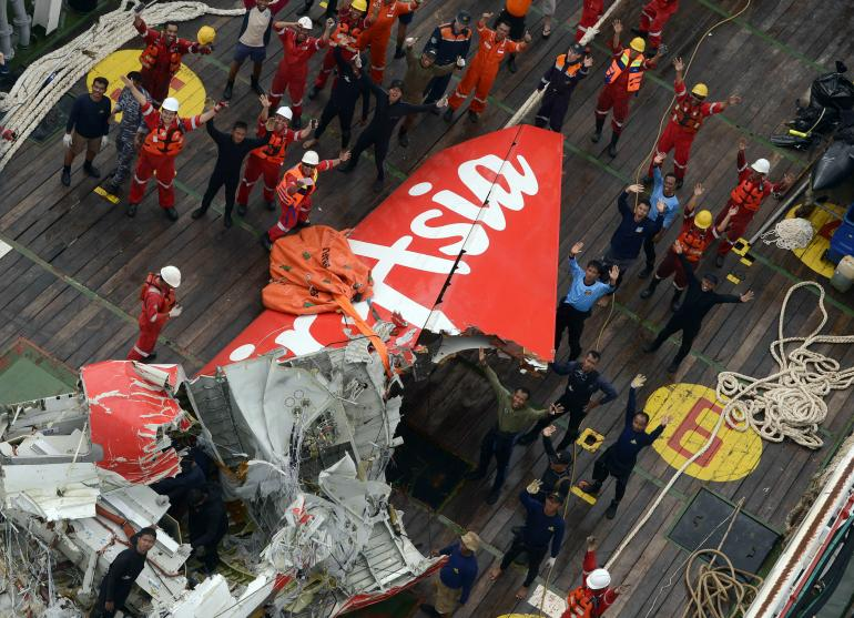 air asia tail recovered from ocean