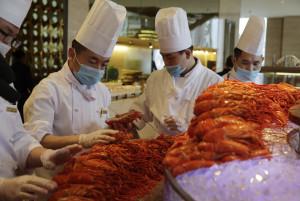chefs prepare boston lobster