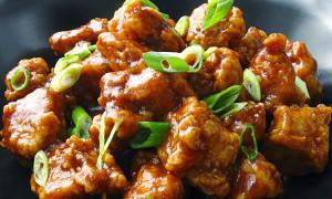 general tso chicken on black plate