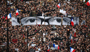 people march in the centre of paris with banners