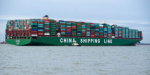 side view cargo ship at sea coming into china