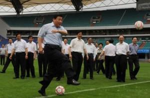 side view xi jinping kicking a football