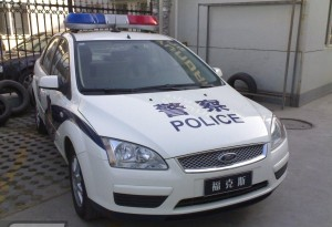 front view police car parked in china