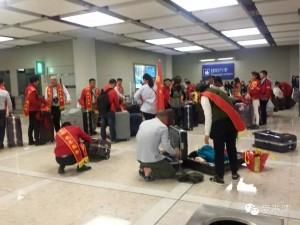 mainland travelers at hong kong airport wearing sashes saying they are not shopping