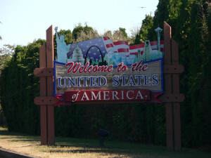 front view roadside sign welcoming people to america