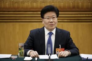 front view Xinjiang Communist Party Secretary Zhang Chunxian answers a question in Beijing
