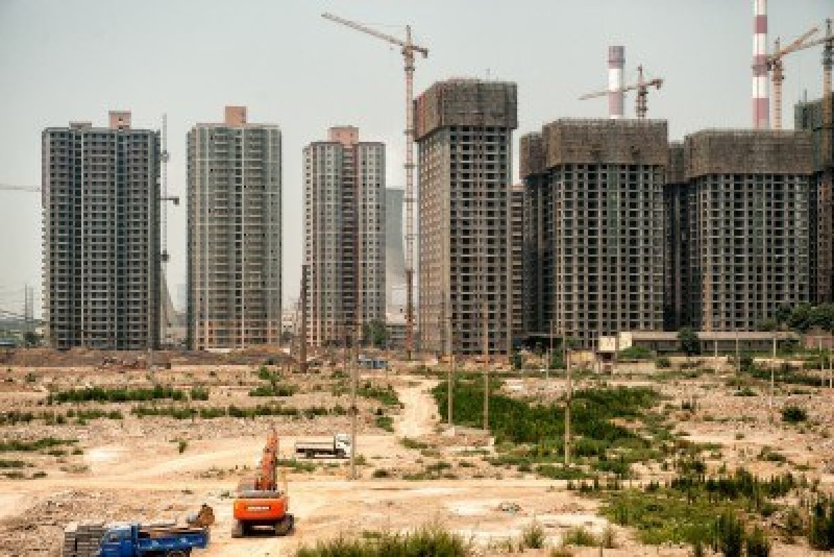 skyscrapers under construction in countryside