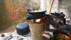 firewood burning under black cooking pot