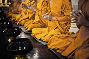 row of buddhist monks kneeling