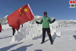 Chen Penbin posing for a picture waving the china flag