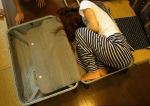 top view open luggage case with woman inside