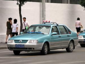 shanghai taxi driving down the street
