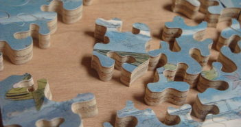 jigsaw pieces spread out on a table