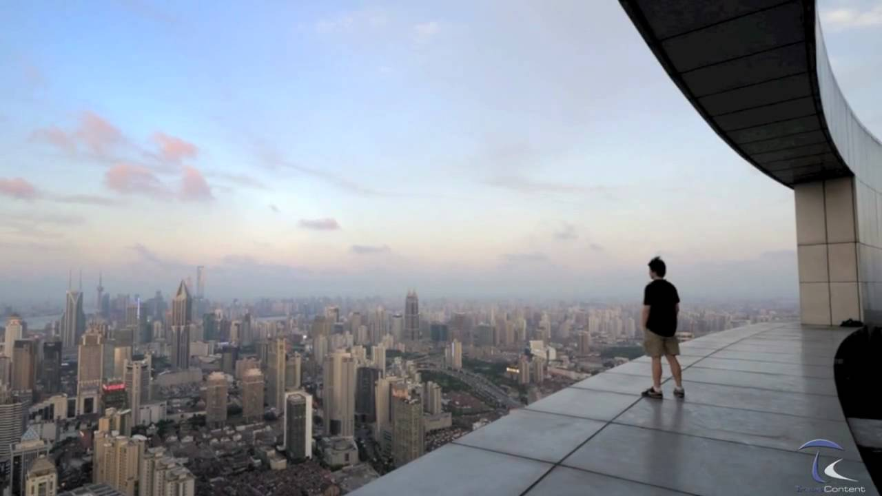 man standing on a ledge overlooking the city china