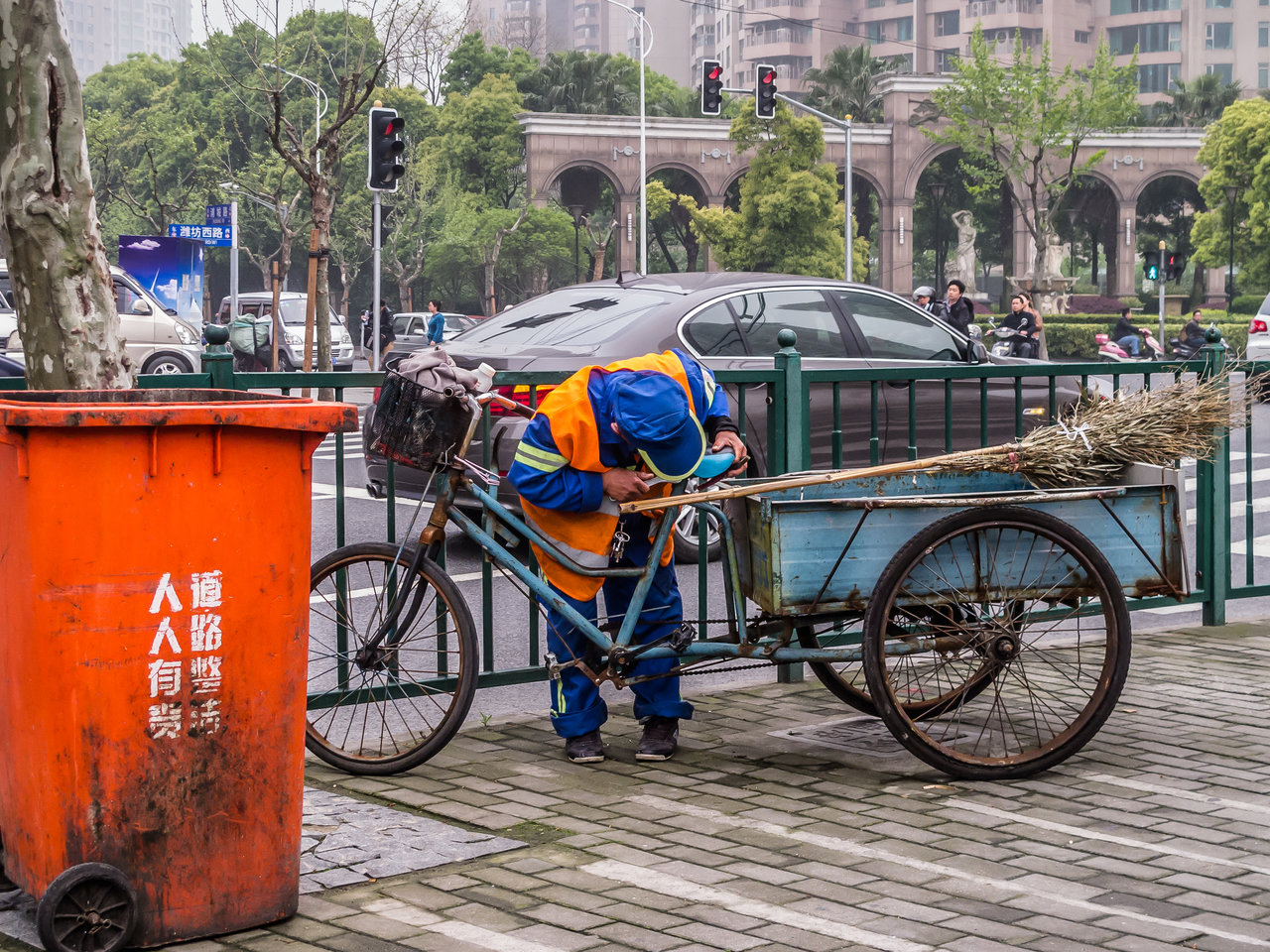 street cleaner inspecting his bike in china