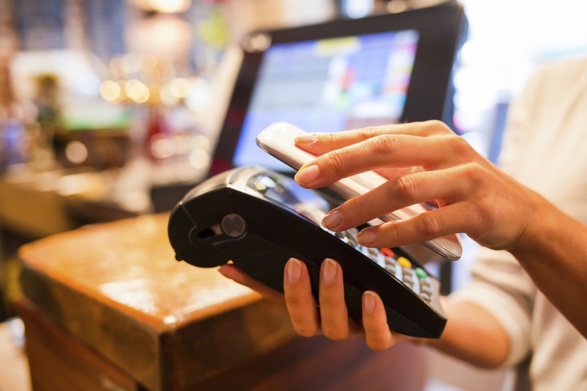 mobile phone being used to make a payment