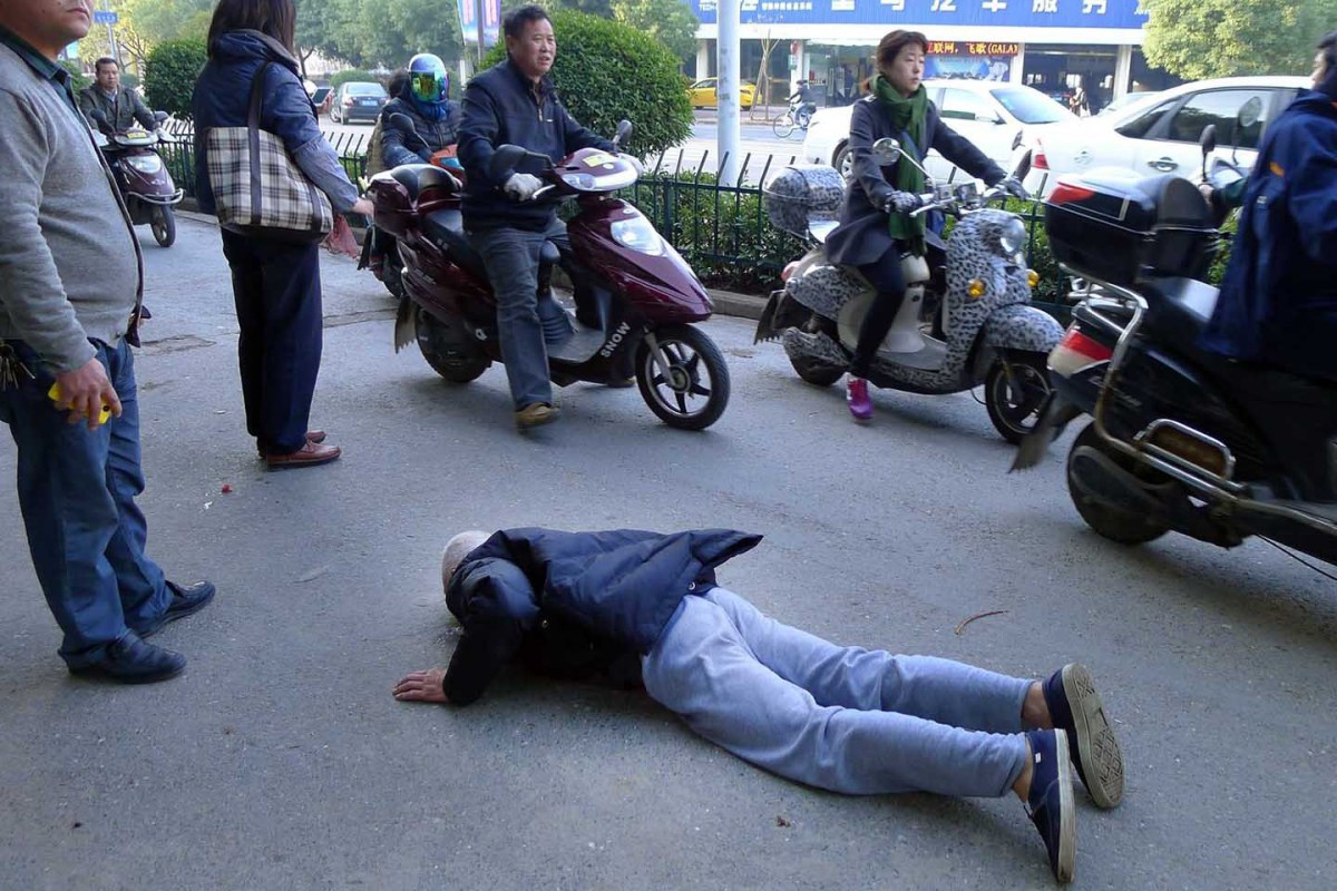 man lying face down on the street
