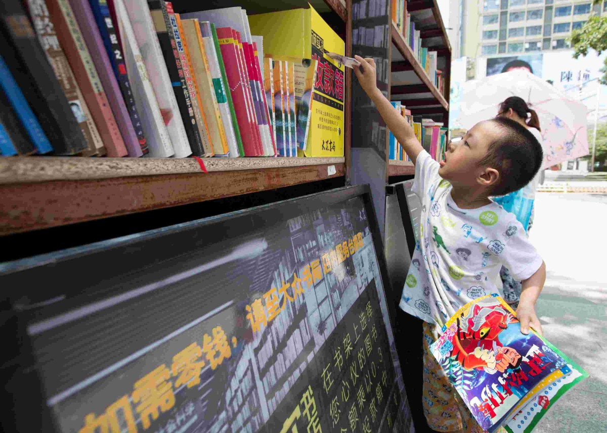 child buying book from 'pay as you feel' bookstore in nanjing