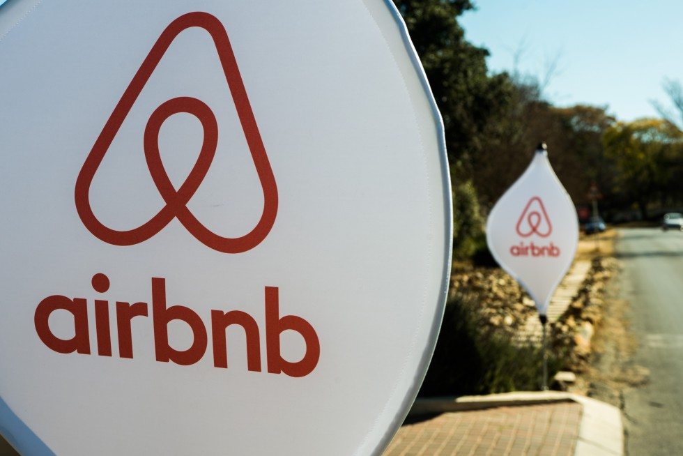 airbnb logo on signs on the road