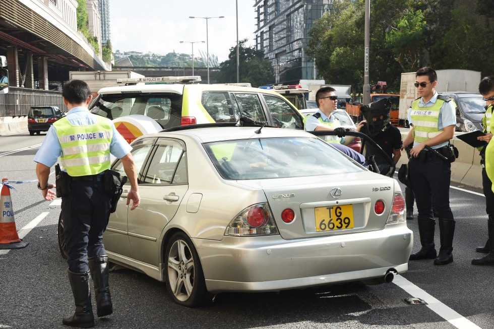 man in police custody after car chase in hong kong