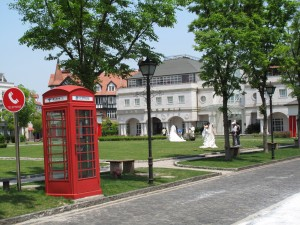 red British phone box and wedding photographs thames town