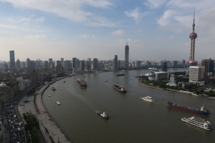 side view of huangpu river in shanghai on a cloudy day