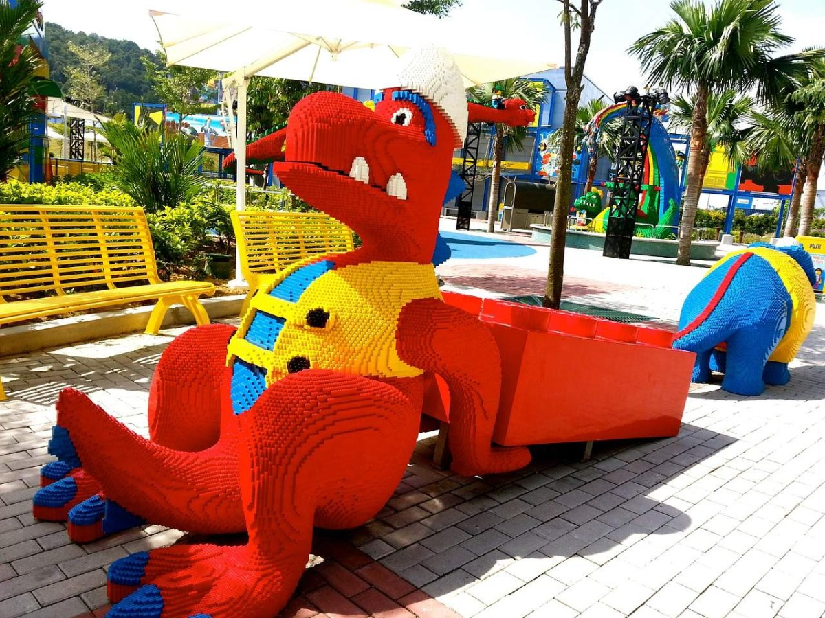 side view or red dinosaur made of lego