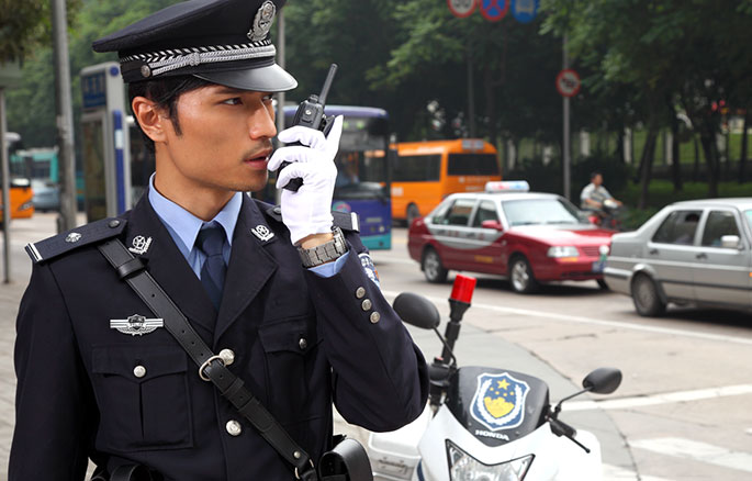 chinese traffic officer on his radio