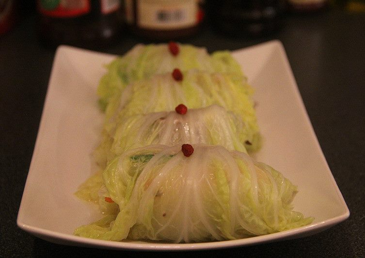 cabbage vegetable rolls on a white plate