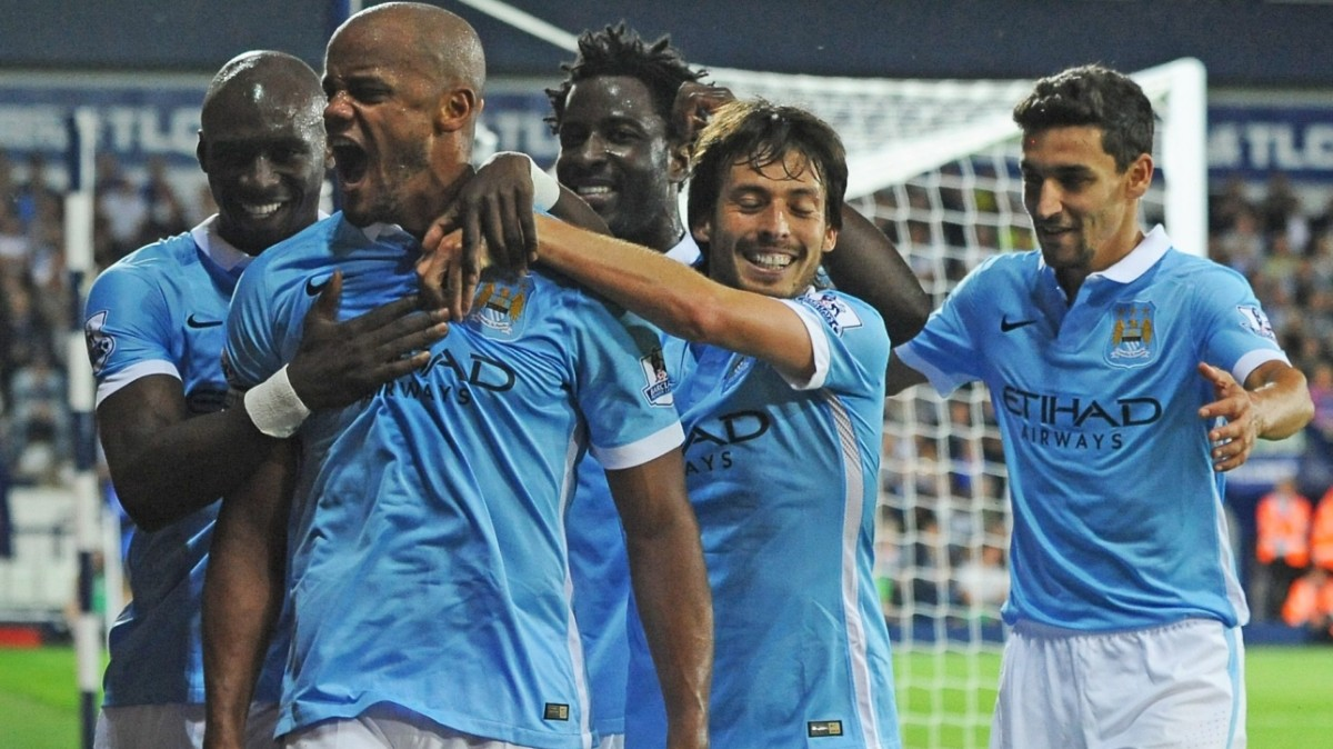 manchester city players celebrating after scoring a goal