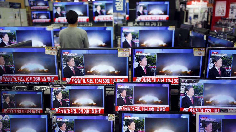 shop with multiple TVs broadcasting the news of north korea's h-bomb detonation