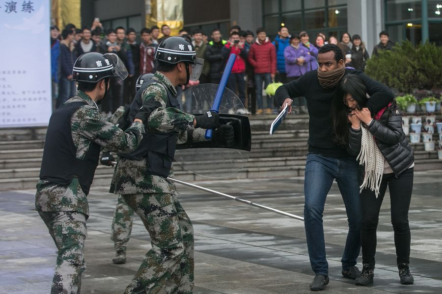 foreign stuent acting as a terrorist in a police exercise in china