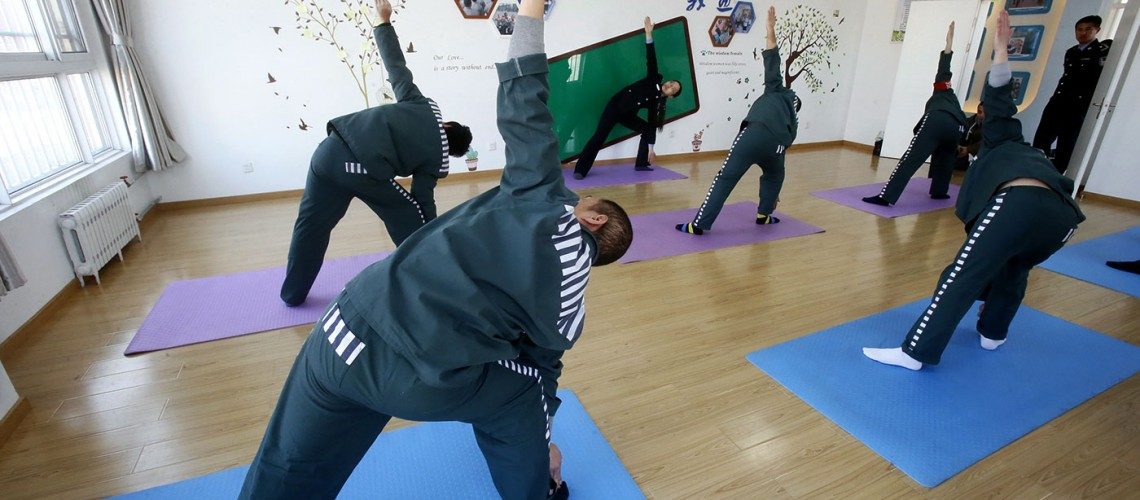 back view of a yoga class in prison for violent offenders in china